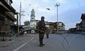 Security personnel stand guard on a street in Srinagar. Photograph: Tauseef Mustafa/AFP/Getty Images